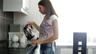 Observe the sexually hot young beauty on the kitchen