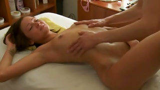 Tiny tittied odorous beauty is getting her body massaged