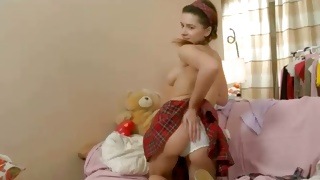 Sexually sweet doll going to take the clothes off her body
