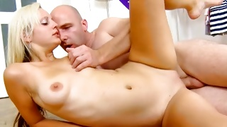 Blonde vulgar bitch is getting the tits pinched by a guy