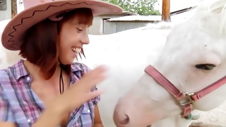 Horny babe on the ranch wearing a sexy hat on porn