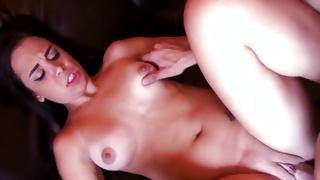 Slutty brunette sitting on coach having skype sex