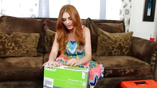 Seductive whore is opening a huge package