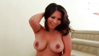 Naughty slut is rubbing her large perfect tits