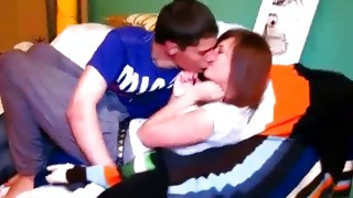Shy brown-haired lass is smiling while guy kissing her sweet lips